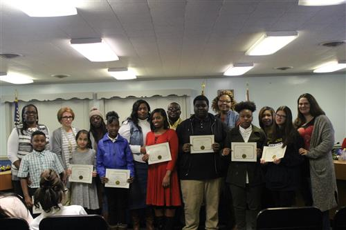 January Character Education Students with Parents-Courage